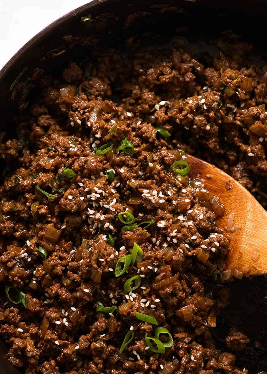 Close up of Asian Ground Beef in a black skillet, ready to be served