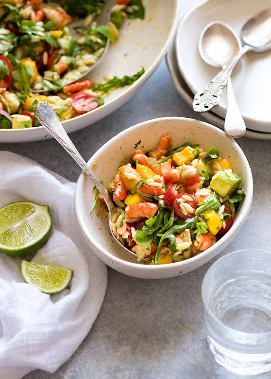 Prawn Mango Avocado Summer Salad with Lime Dressing in a white bowl, ready to be eaten